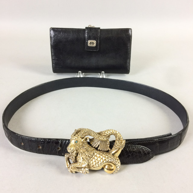 Gucci Black Leather Wallet and Leather Belt with Sterling Silver Ram Buckle, buckle with gem-set eyes, (imperfections). (Lot 2303, Estimate: $60-80)