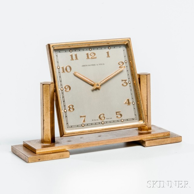 Abercrombie & Fitch Eight-day Brass and Glass Desk Clock, mid-20th century   (Estimate: $100-200)
