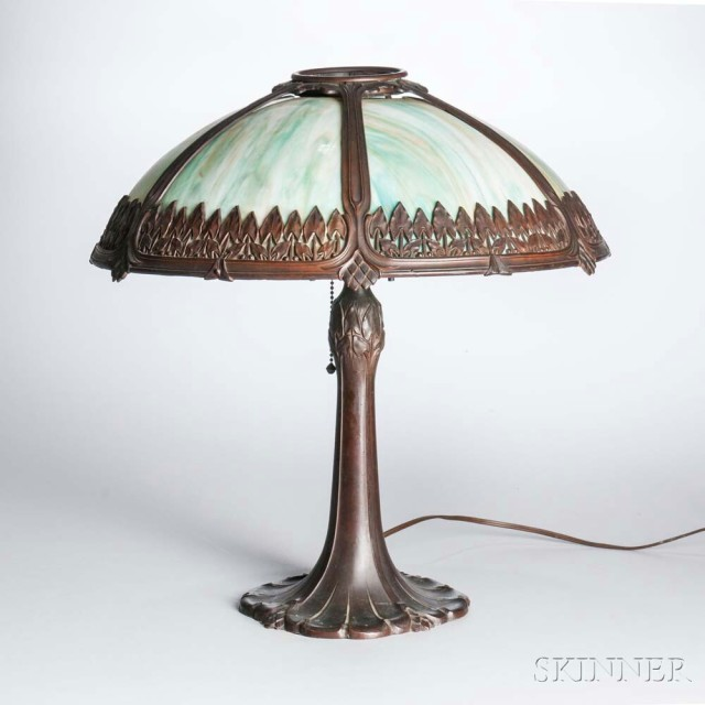 Arts and Crafts Cast Metal and Slag Glass Table Lamp, early 20th century (Lot 1027, Estimate: $300-500)