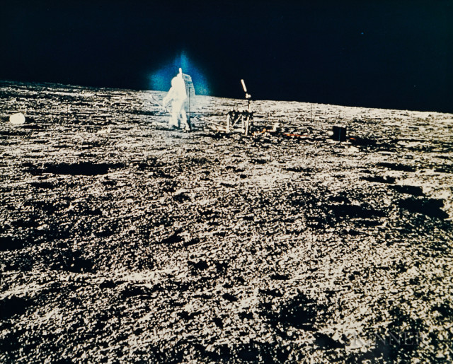 Bluish halo around Alan Bean at the lunar-science station, EVA 1, Apollo 12, November 1969 (Estimate $400-600)