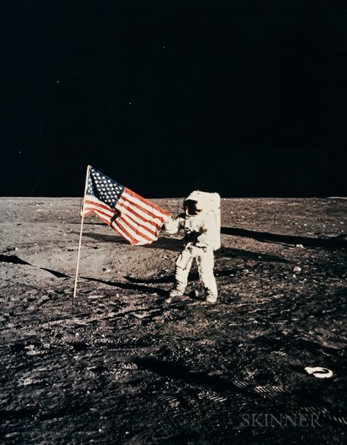 Pete Conrad and the American flag on the Ocean of Storms, Apollo 12, November 1972 (Estimate $2,000-3,000)