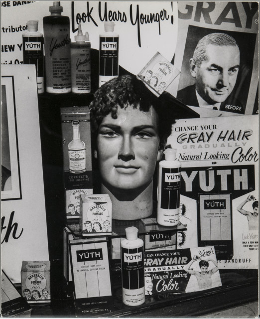 """Hair Care Shop Window Off Broadway, New York City, Made for Unpublished Fortune Magazine Portfolio """"The Clothes: A Note on Sartorial Actuality,"""" 1963 (Lot 136, Estimate: $2,000-3,000)"""